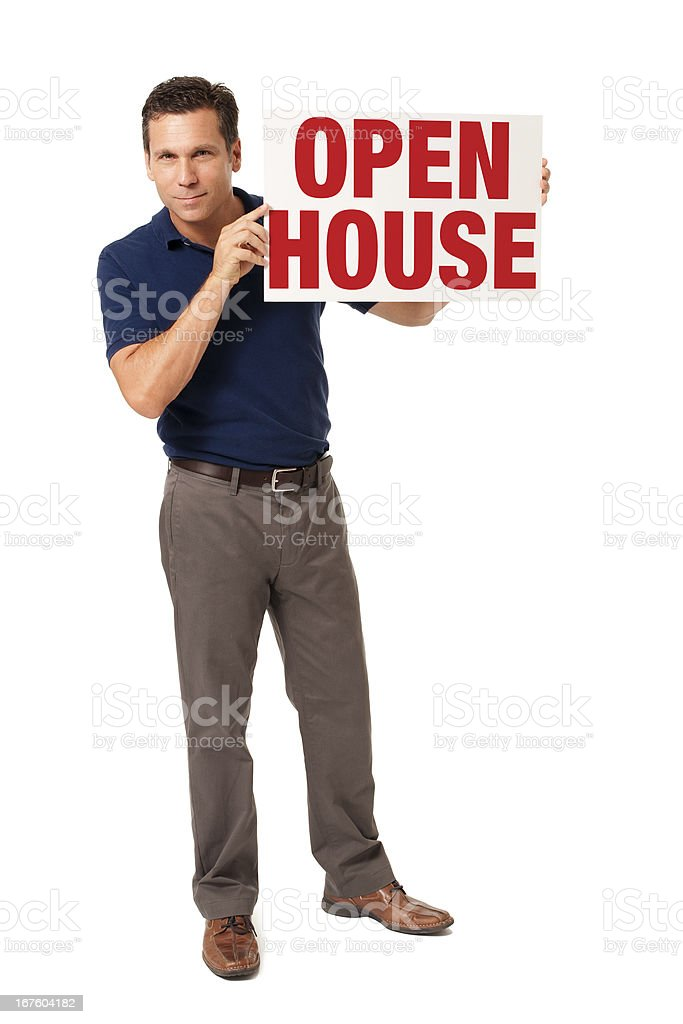 Causal Businessman with Open House Sign Isolated on White Background royalty-free stock photo