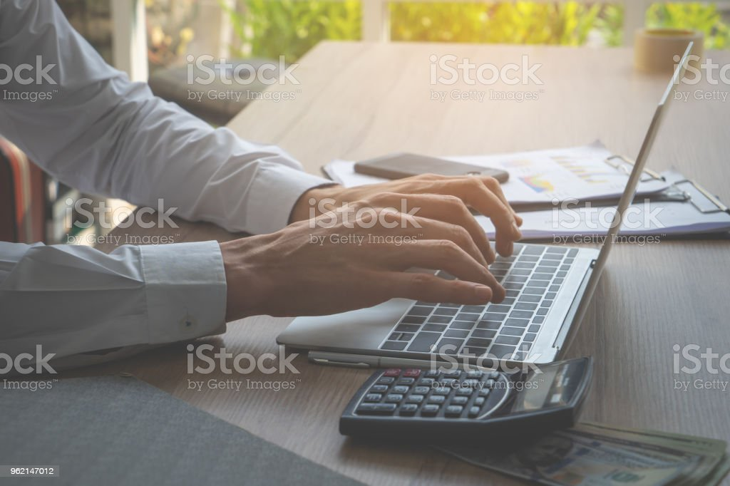 Causal male accounting worker hand using Computer laptop stock photo