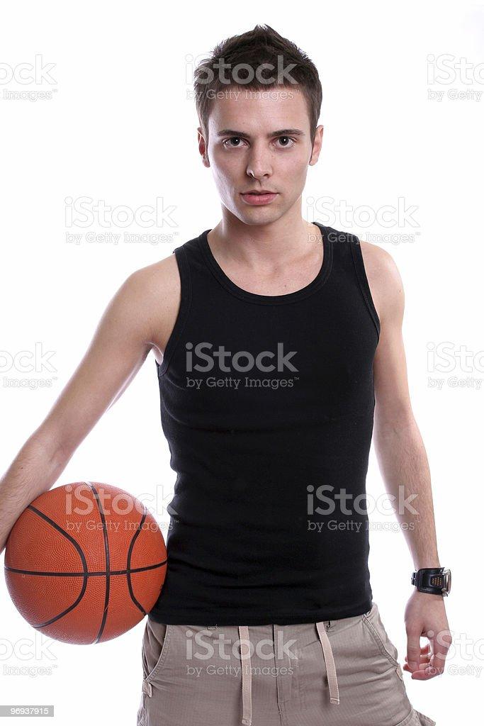 Causal man holding basketball ball royalty-free stock photo
