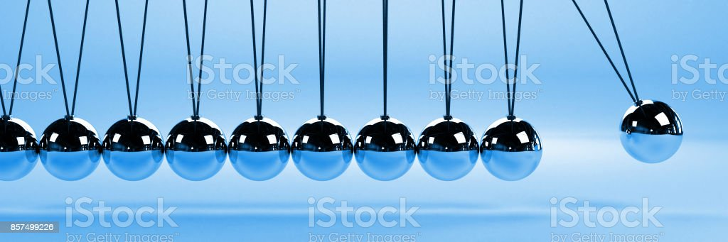 cause and effect concept banner, metal Newton's cradle on a blue background, 3D illustration stock photo
