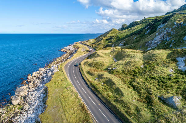 causeway costal route in northern ireland, uk - car view imagens e fotografias de stock