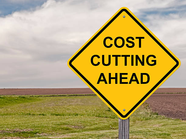 Caution - Cost Cutting Ahead Caution Sign - Cost Cutting Ahead miserly stock pictures, royalty-free photos & images