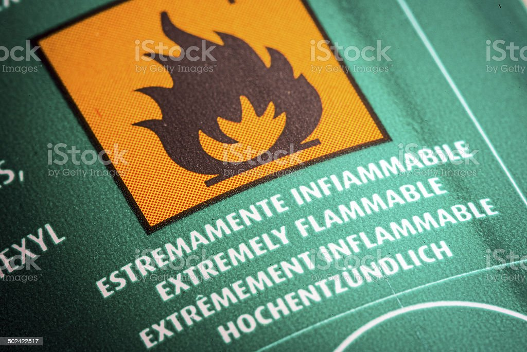 Caution flammable label macro stock photo