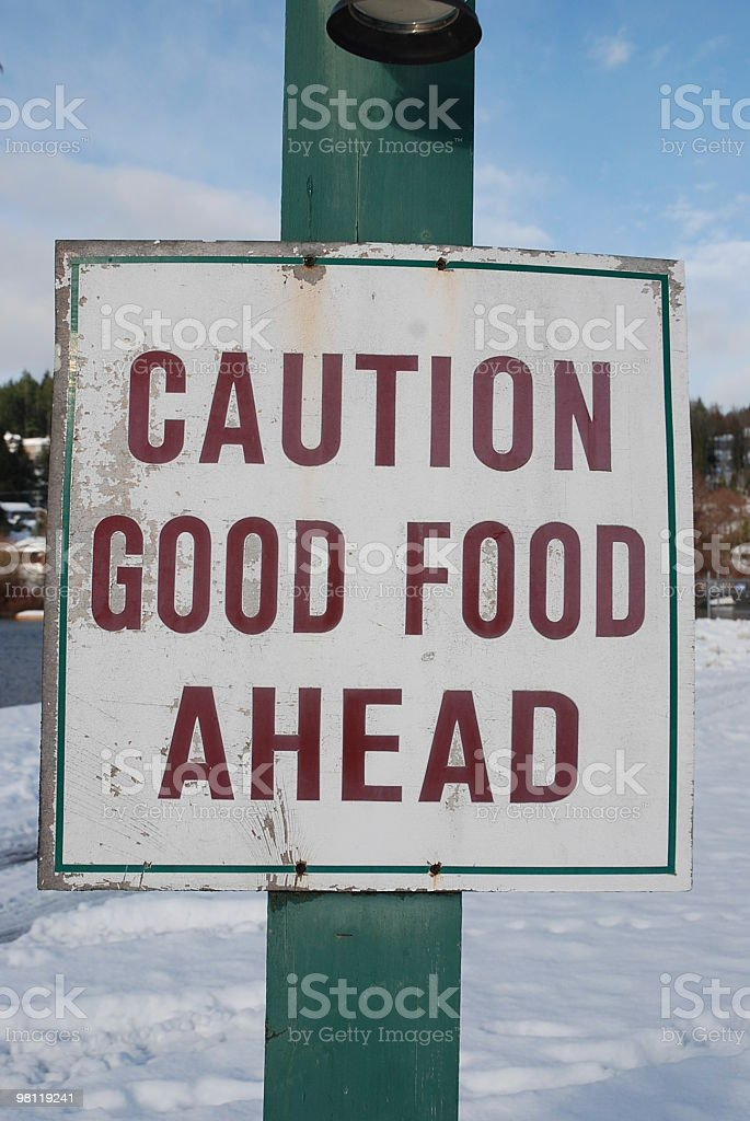 Caution Good Food Ahead Sign royalty-free stock photo