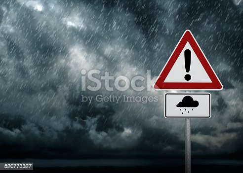 A dark cloudy sky with rain and warning sign - computer generated image