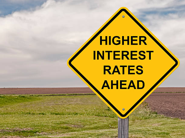 caution - higher interest rates ahead - interest rate stock photos and pictures