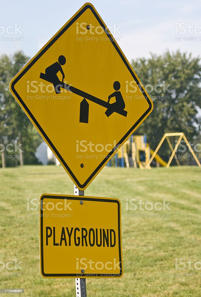 caution playground sign royalty-free stock photo