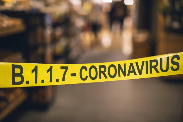 Caution Quarantine Area - B.1.1.7 Coronavirus tape barrier stock photo