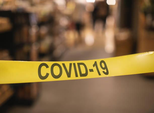 Caution Quarantine Area - Covid-19 tape barrier stock photo