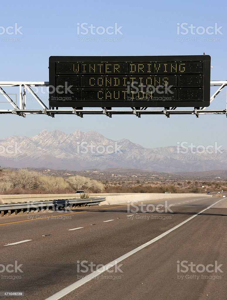 Caution Sign Above the Highway royalty-free stock photo