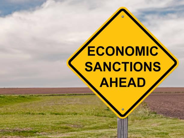 Caution Sign - Economic Sanctions Ahead Sign warning that Economic Sanctions are Ahead sanctions stock pictures, royalty-free photos & images