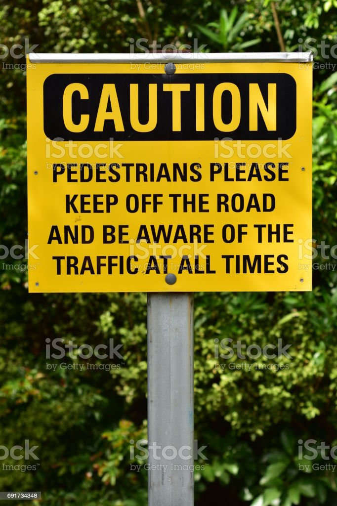 Caution sign for pedestrians stock photo