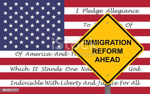 istock Caution Sign - Immigration Reform Ahead With American Flag Background And Pledge Of Allegiance 853307072