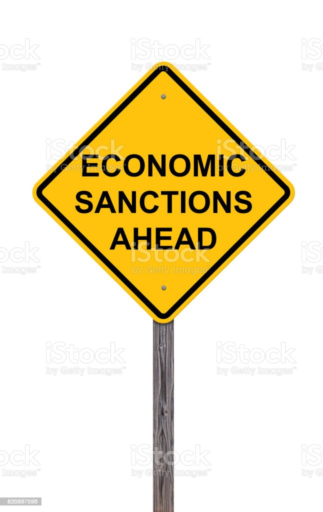 Caution Sign Isolated On White - Economic Sanctions Ahead stock photo