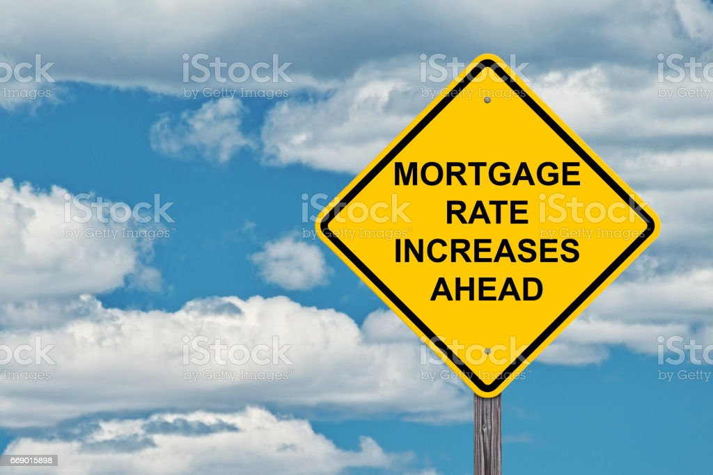 caution sign mortage rate increases ahead stock photo