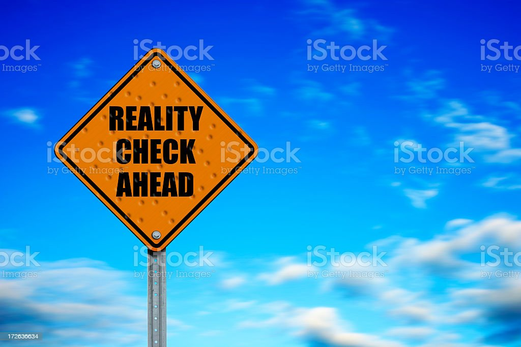 A caution signage saying REALITY CHECK AHEAD stock photo