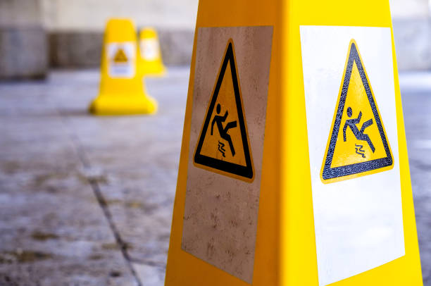 caution slippery surface sign caution wet floor sign at a sidewalk slippery stock pictures, royalty-free photos & images