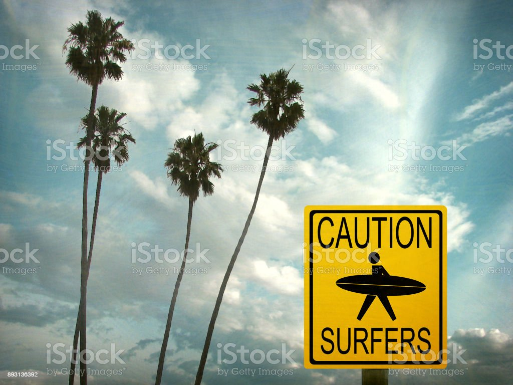 caution surfers sign stock photo