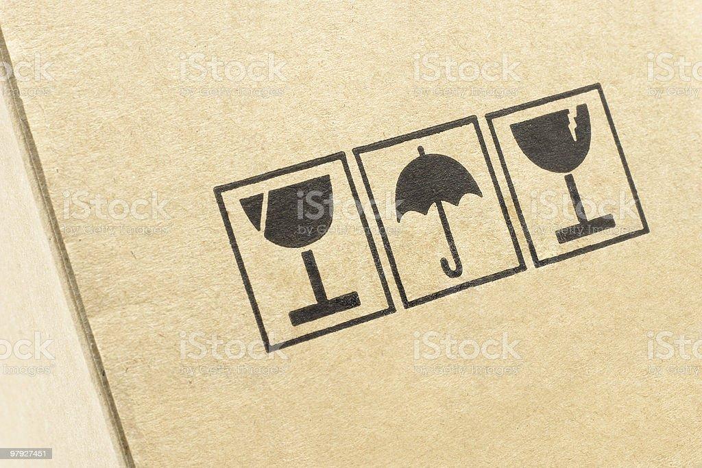 Caution symbols on carton box royalty-free stock photo
