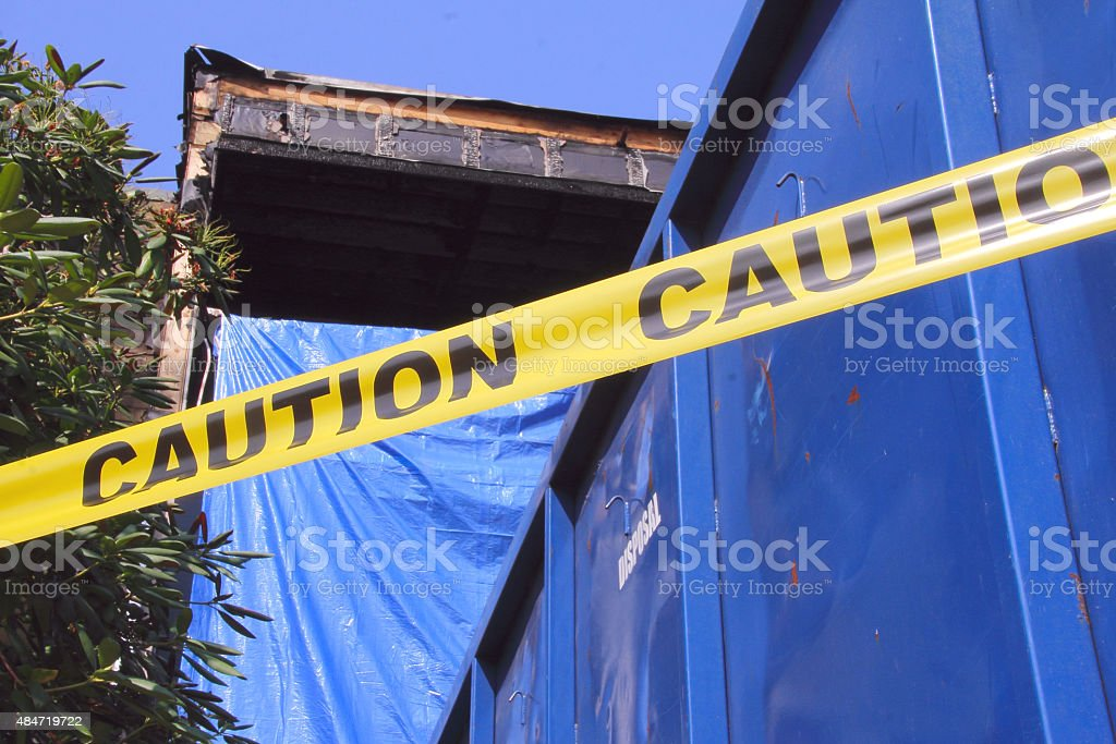 Caution Tape and Apartment Fire stock photo