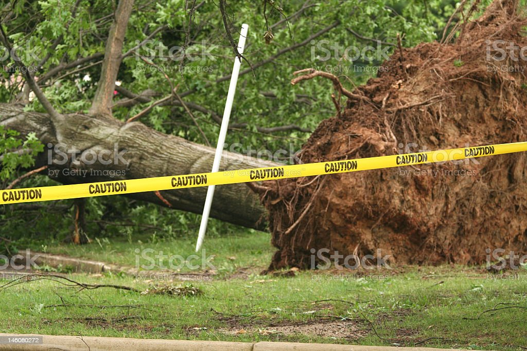 Caution tape blocking storm damage royalty-free stock photo