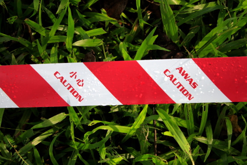 istock Caution tape on grass 452692559
