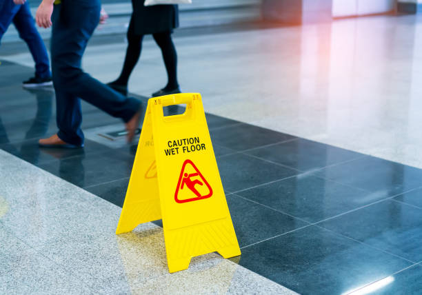 Caution wet floor Caution wet floor falling stock pictures, royalty-free photos & images