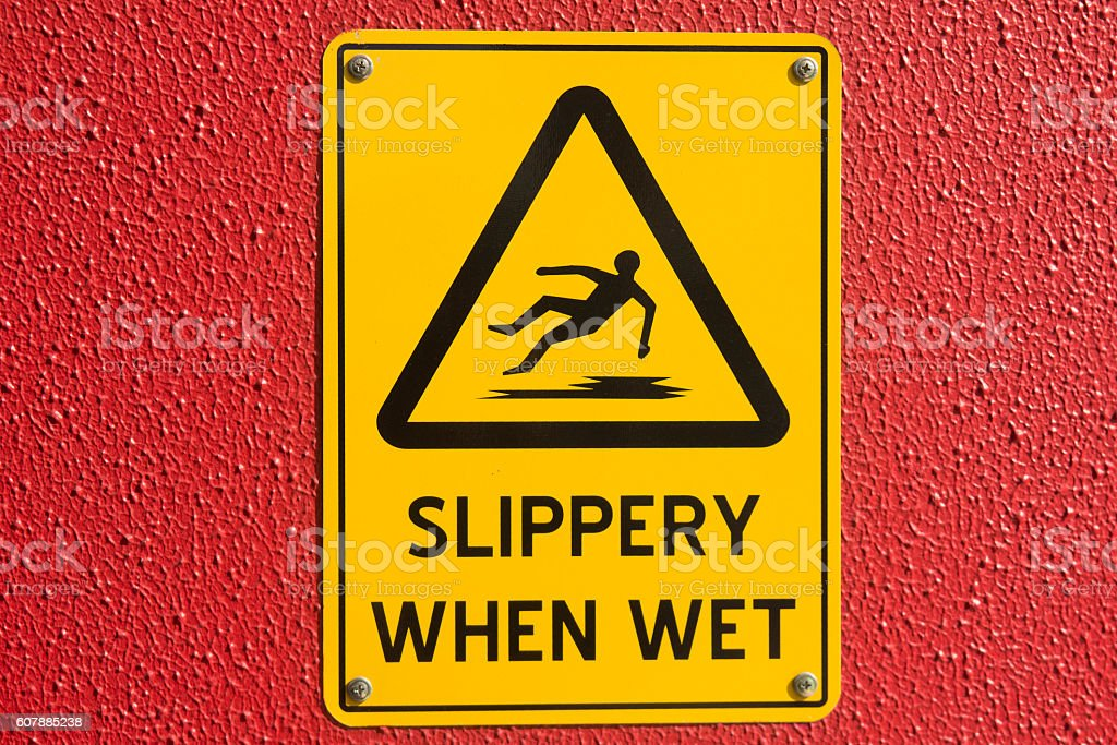Caution wet floor, sign beware slippery. stock photo