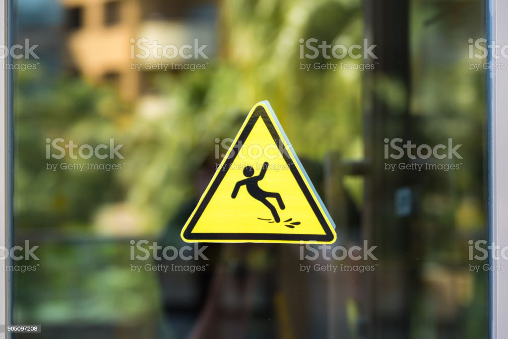 Caution wet floor sign on the glass royalty-free stock photo