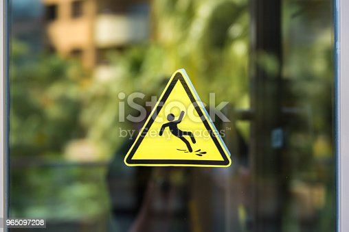 istock Caution wet floor sign on the glass 965097208