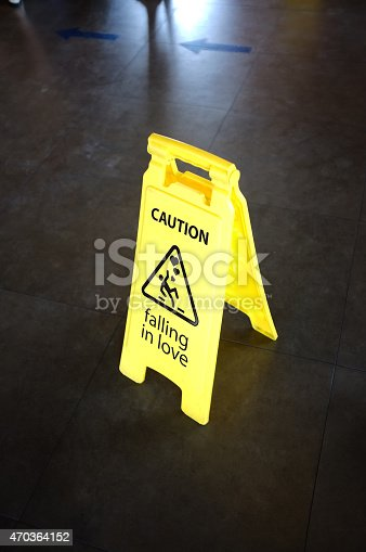 istock Caution yellow sign for warning, falling in love 470364152