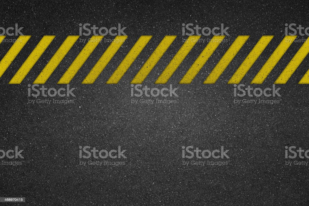 Cautionary yellow line on road texture for backgrounds stock photo