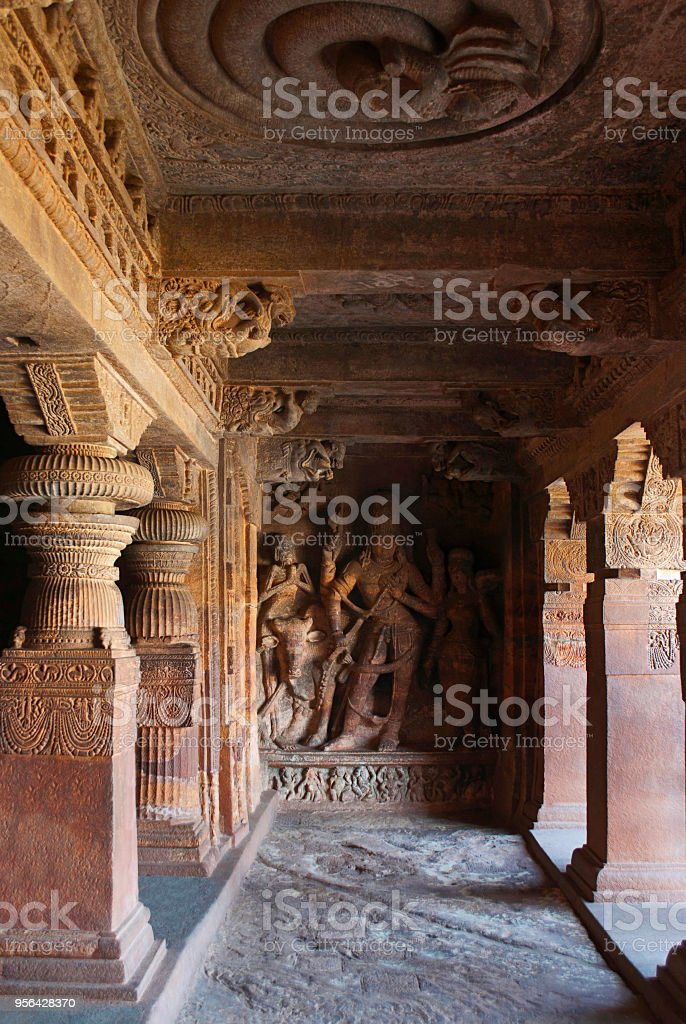 Cave 1: A sculpture depicting Nandi, the bull, Bhringi, a devotee of Shiva; a female decorated goddess, all of which are part of Ardhanarishvara, Badami Caves, Karnataka, India. Interior right side wall. stock photo