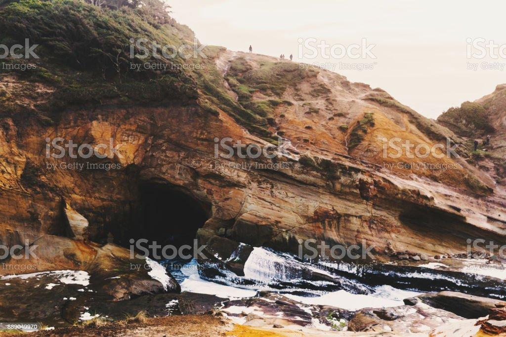 Cave and Cliffside at Cape Kiwanda stock photo