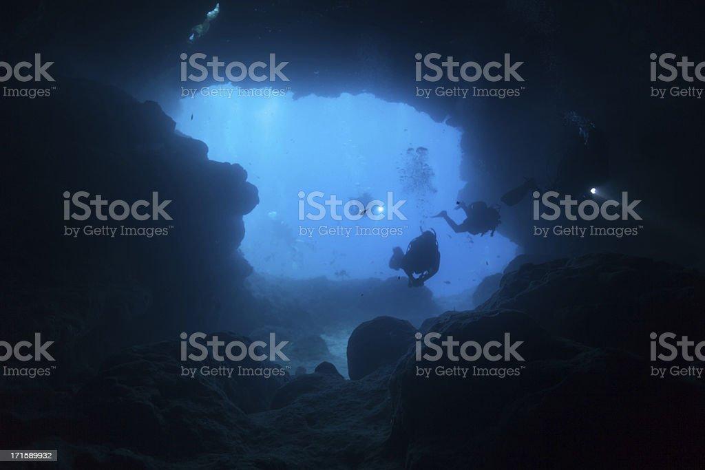 Cave Divers dive into the Santa Maria Caves, Comino, Malta royalty-free stock photo