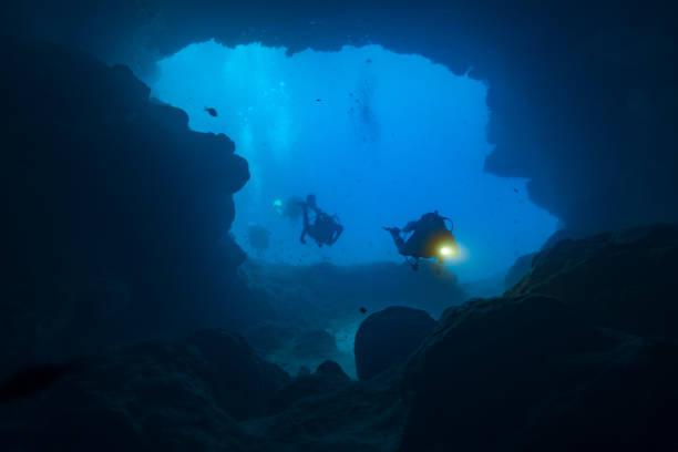 Cave Divers Exploring the Santa Maria Caves, Comino, Malta stock photo