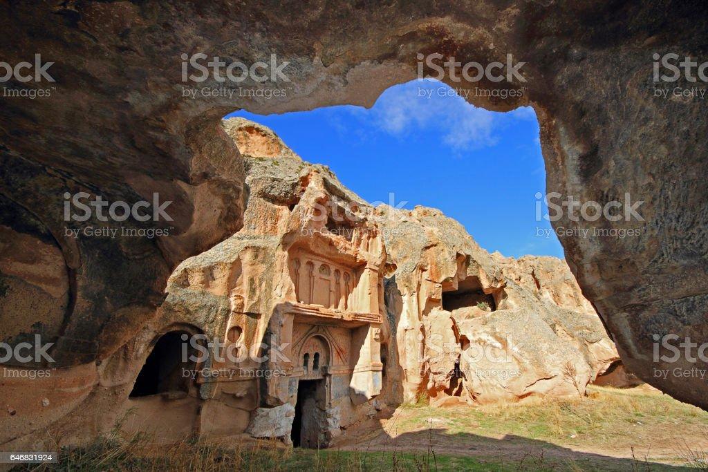 Cave dwellings and ancient rock cut churches in Aciksaray, Cappadocia. stock photo