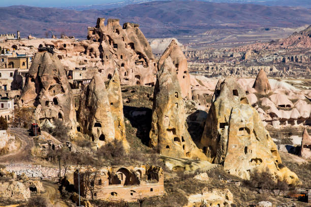 cave houses and rock formations - cappadocia in turkey - tar texture imagens e fotografias de stock