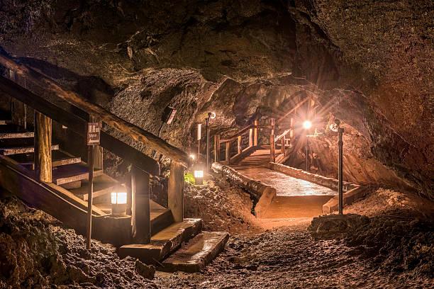 Cave of Mt. Fuji Fujikawaguchiko-machi, Japan - November 2, 2015: The walking route inside Lake Saiko Bat Caves. The caves were formed by past Mt. Fuji eruptions. lake kawaguchi stock pictures, royalty-free photos & images