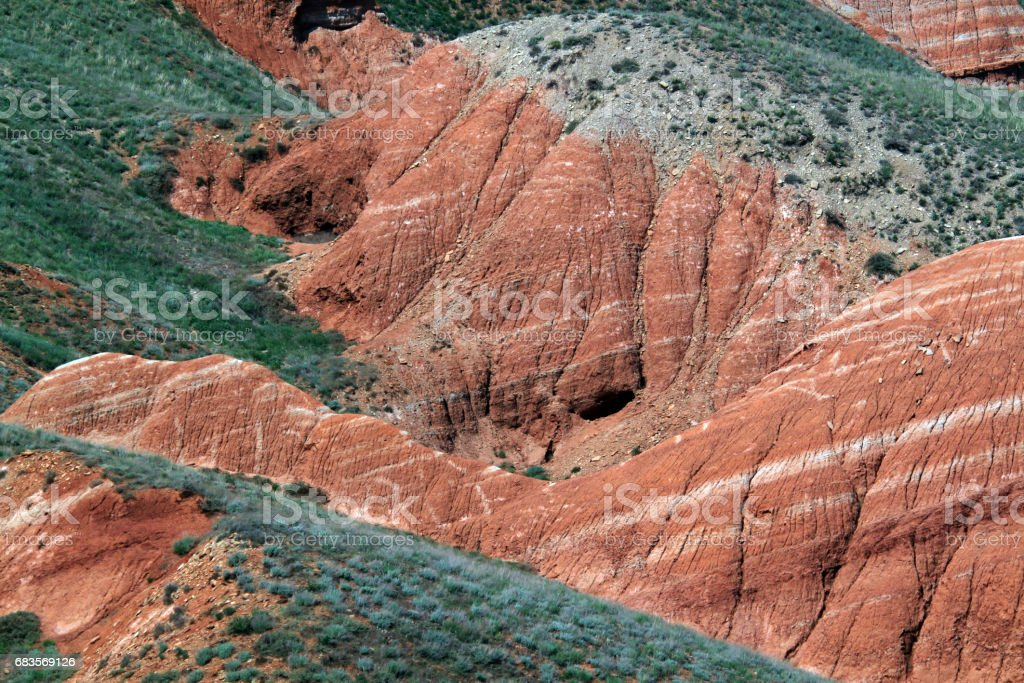 Cave of the primitive people in the slope of rainbow mountain stock photo