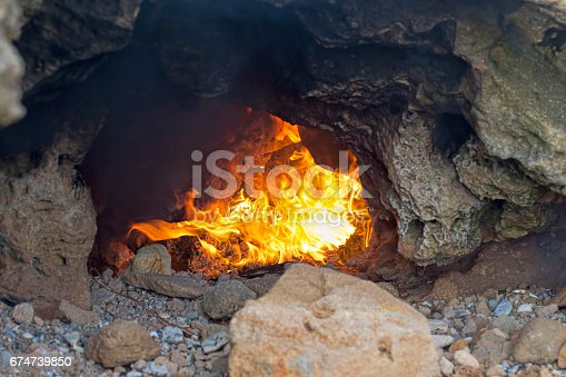 istock Cave with fire 674739850
