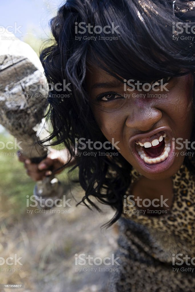 Cave Woman Growls With Club royalty-free stock photo