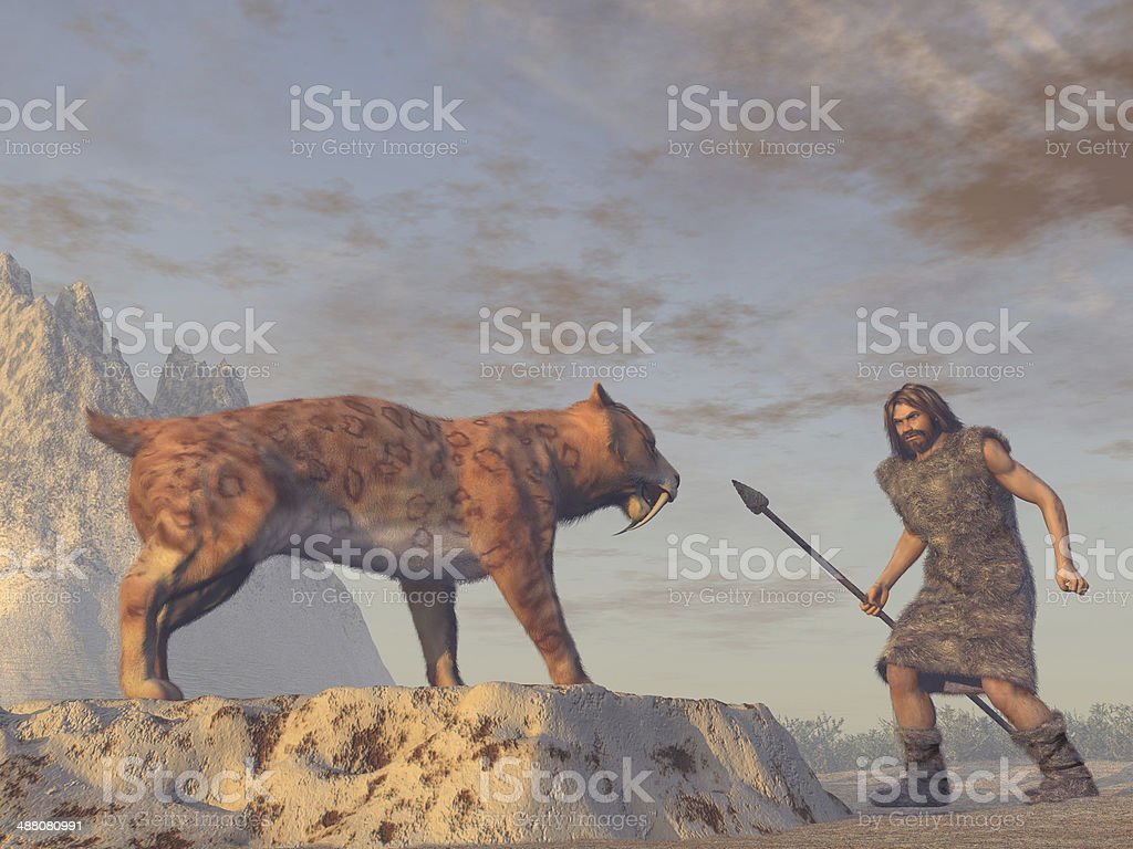 Caveman and Saber Tooth Tiger stock photo