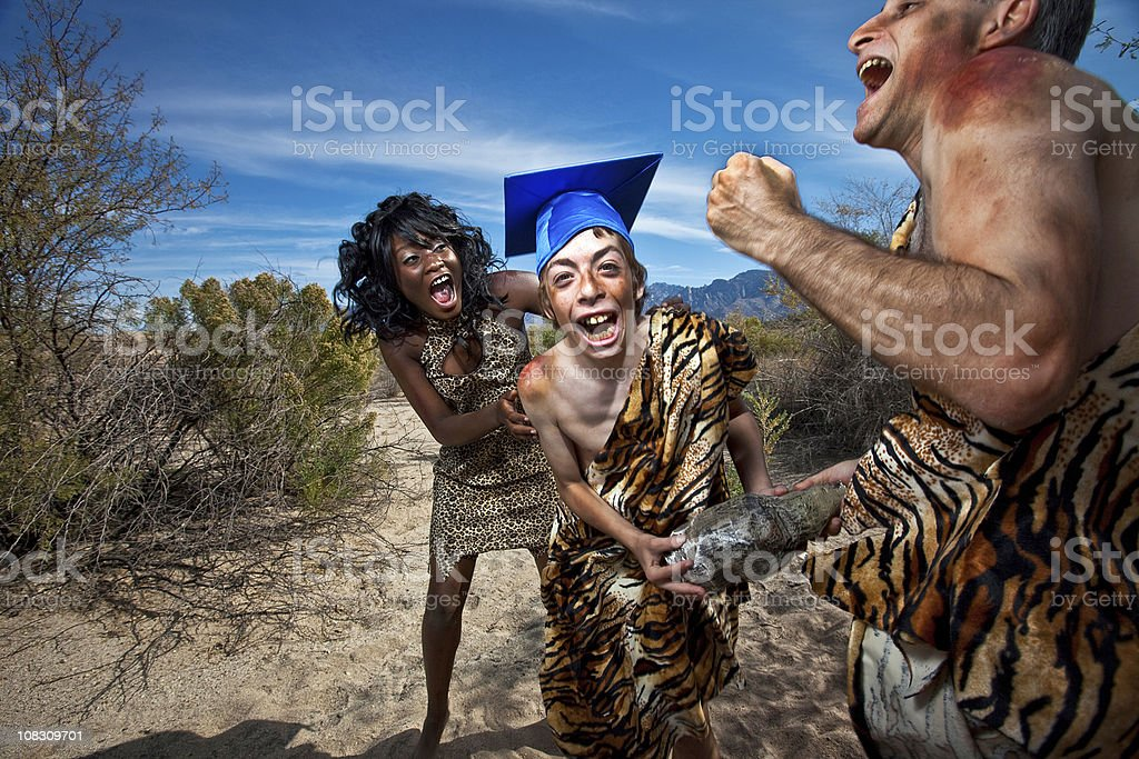 Caveman Graduation stock photo