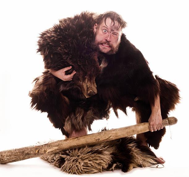 Caveman in bear skin stock photo