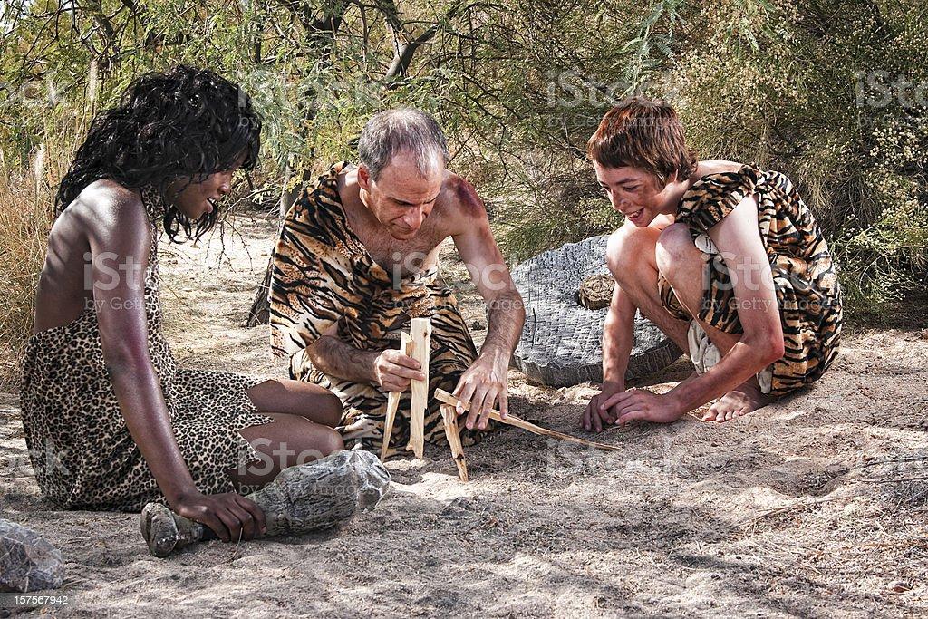 Caveman Making Fire stock photo