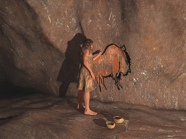 Caveman painting in a cave stock photo