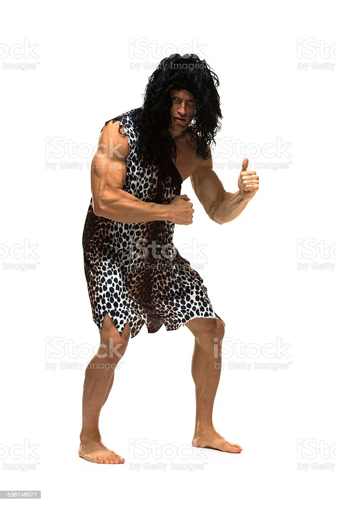 Caveman showing thumbs up stock photo