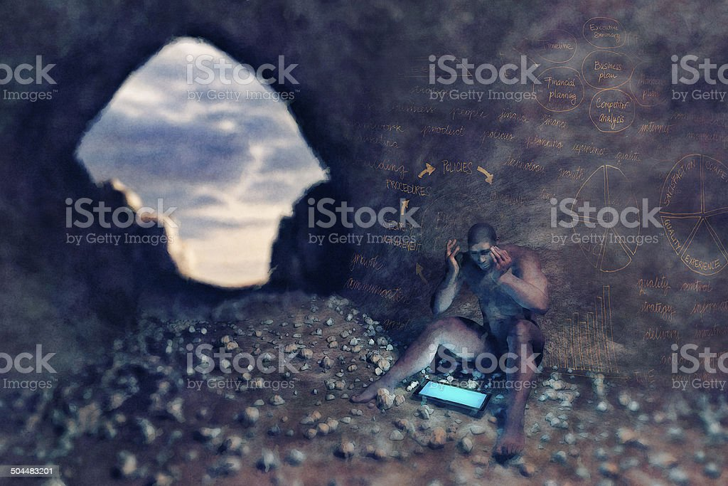 Caveman with digital tablet and business problems stock photo