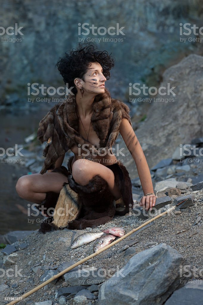 cavewoman and her capture stock photo
